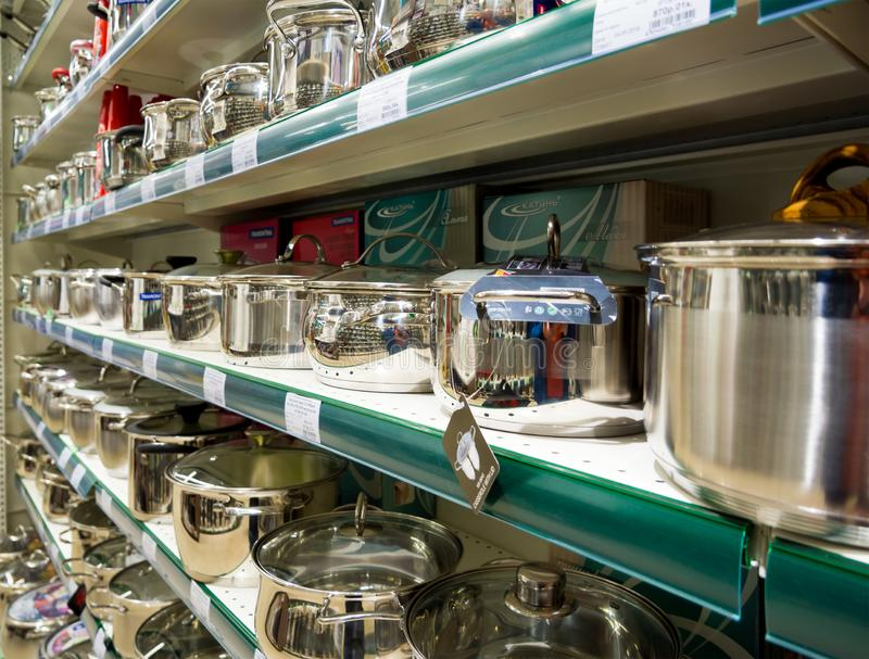Shelves with new pans in the store royalty free stock photo