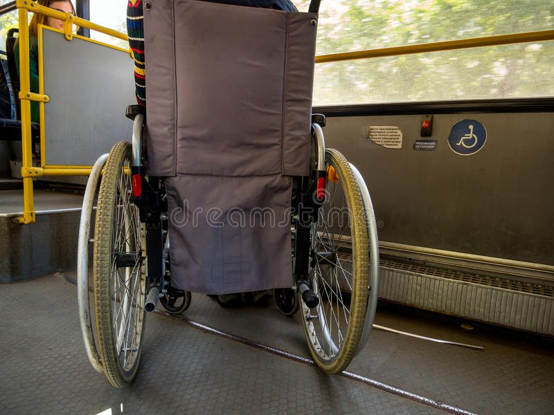 Wheelchair is in the public transport stock photography