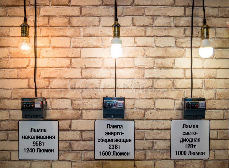 An experiment to evaluate the effectiveness of different types of light bulbs. Voronezh, Russia - October 21, 2018: An experiment to evaluate the effectiveness stock photography