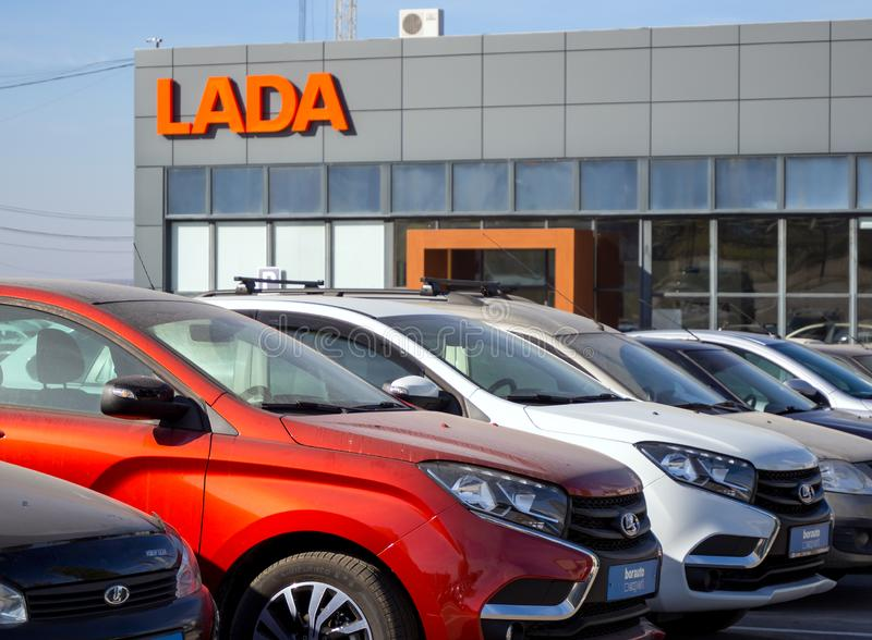 A number of new cars brand `LADA` at the dealer building royalty free stock photos
