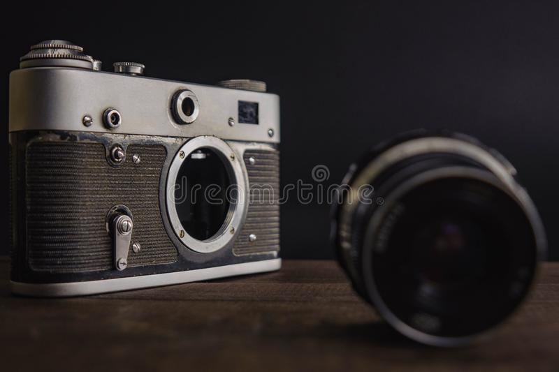 old vintage soviet camera with lens on wooden background stock images