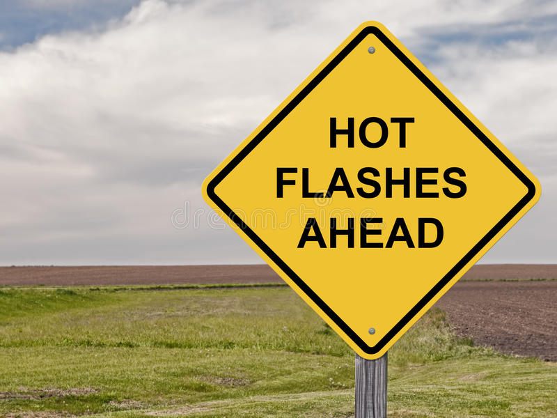 Vorsicht - Hitzewallungen voran stockbild