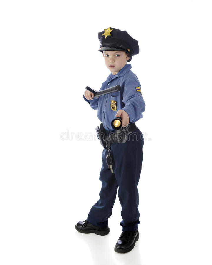Vorsichtiger kleiner Polizist stockfoto