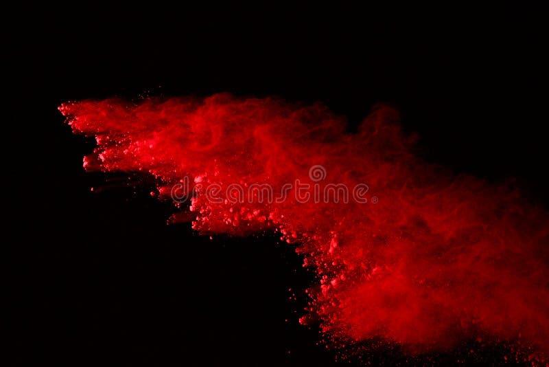 Vorstmotie van gekleurde die poederexplosie op zwarte achtergrond wordt geïsoleerd De samenvatting van Veelkleurig stof splatted royalty-vrije stock foto