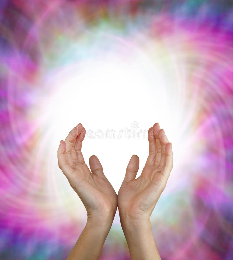 Vortex Energy Field. Female energy worker with hands outstretched and open upwards sensing white healing energy on pink vortexing multicolored energy formation stock photography