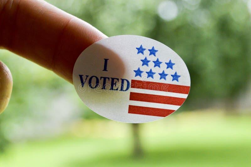 Voté la etiqueta engomada imagen de archivo libre de regalías