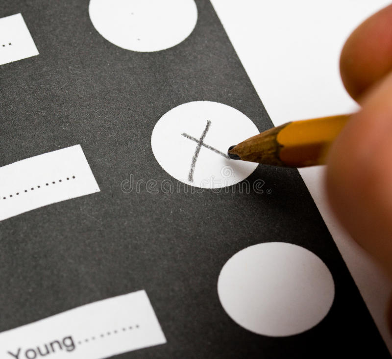 Vote. By marking an x on the ballot - hand with pencil stock photos