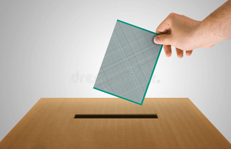 Vote. Human hand insert the electoral document on urn for voting stock illustration