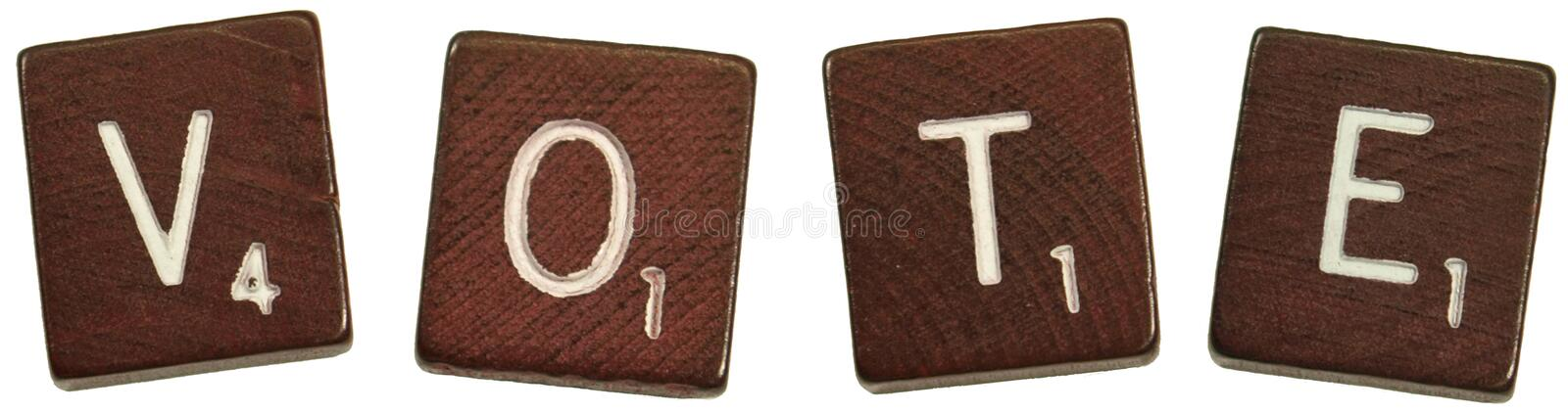 "Vote. Isolated photo of scrabble letters saying, ""Vote royalty free stock images"