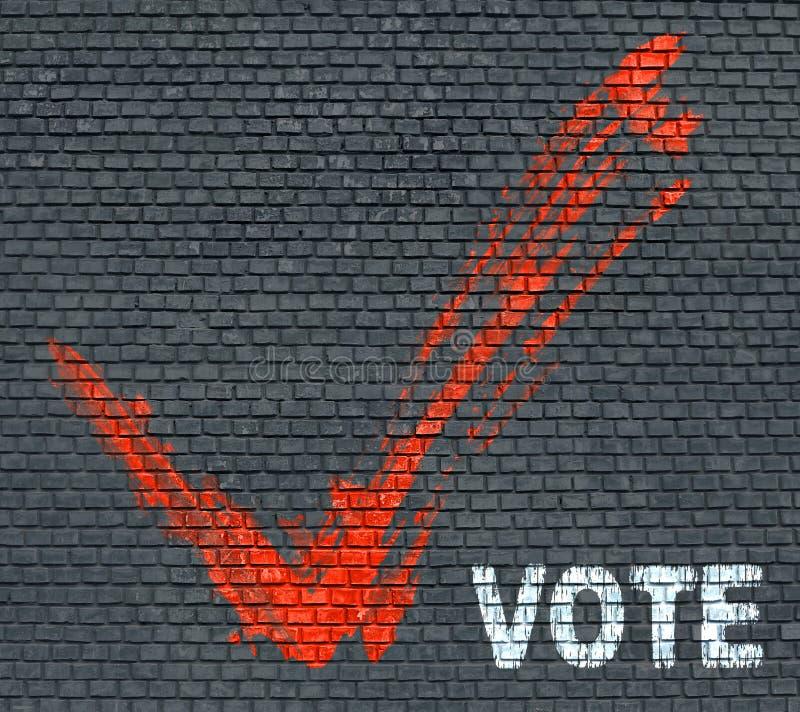 Vote de mot sur un mur de briques photo libre de droits
