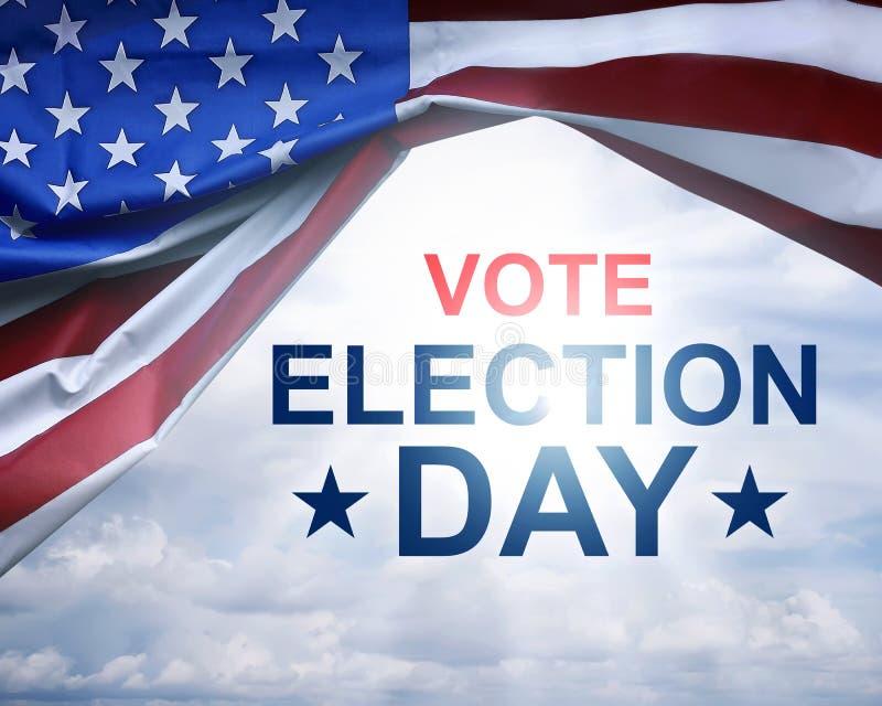 Vote el día de elección escrito encendido debajo de la bandera de los E.E.U.U. imagen de archivo libre de regalías