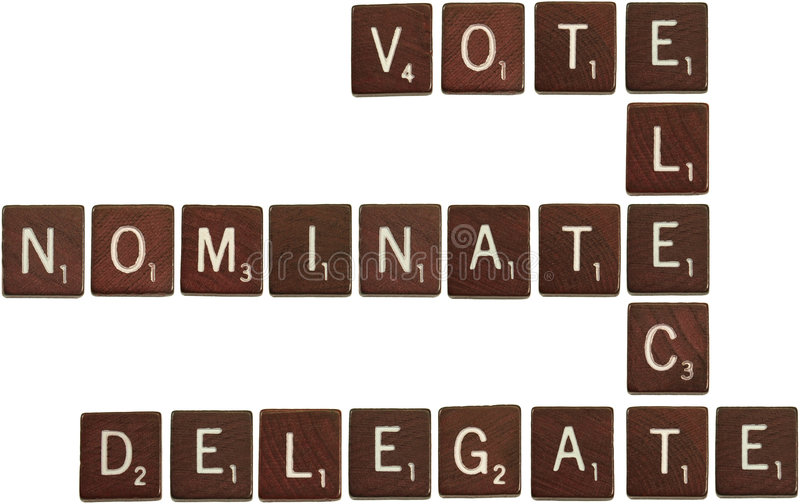 Vote, elect, nominate, delegate scrabble tiles royalty free stock photo
