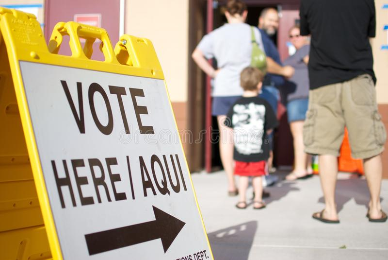 Vote Here Sign and Line stock photography