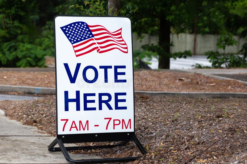 Vote here sign for primaries and elections royalty free stock images