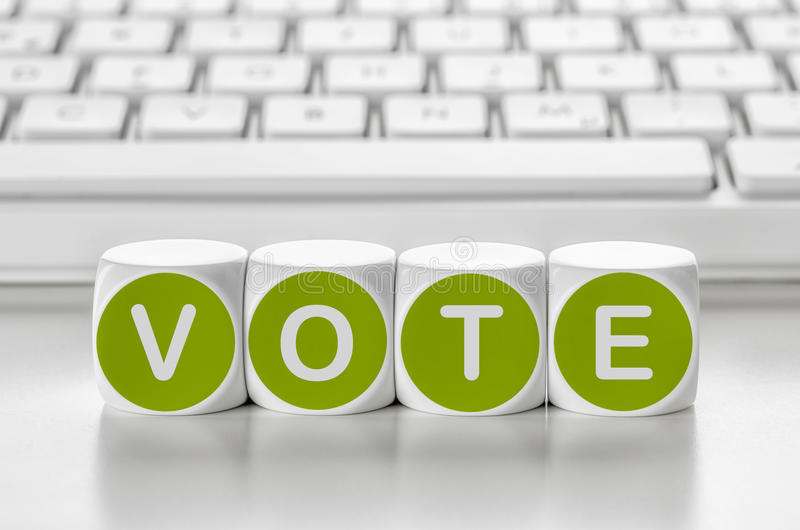 Vote. Letter dice in front of a keyboard - Vote royalty free stock photo