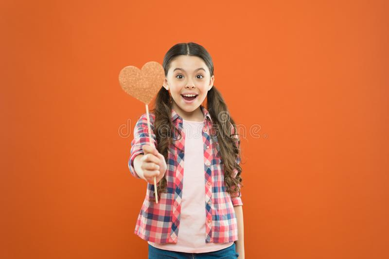 Vote for love. Girl little child hold heart symbol on stick. Like and support. Valentines day. Fall in love. Love will. Save the world. Kid promoting love royalty free stock photo