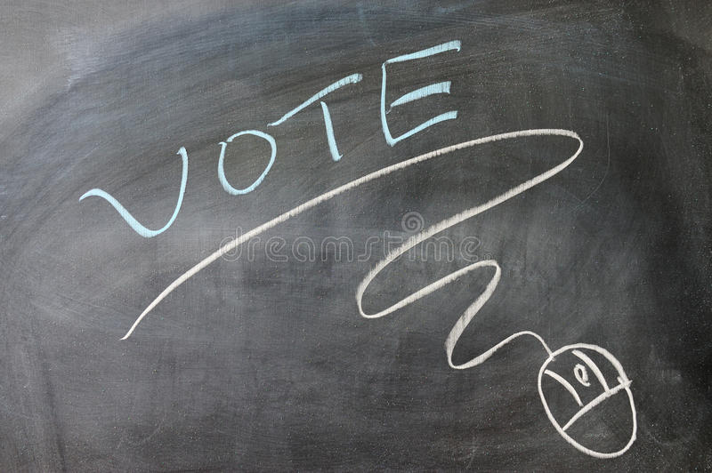 Vote and mouse symbol. Drawn on the blackboard stock photos