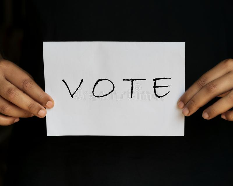 VOTE Now Isolated In Black Background royalty free stock photo