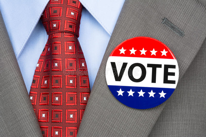 Vote pin on brown suit royalty free stock photography