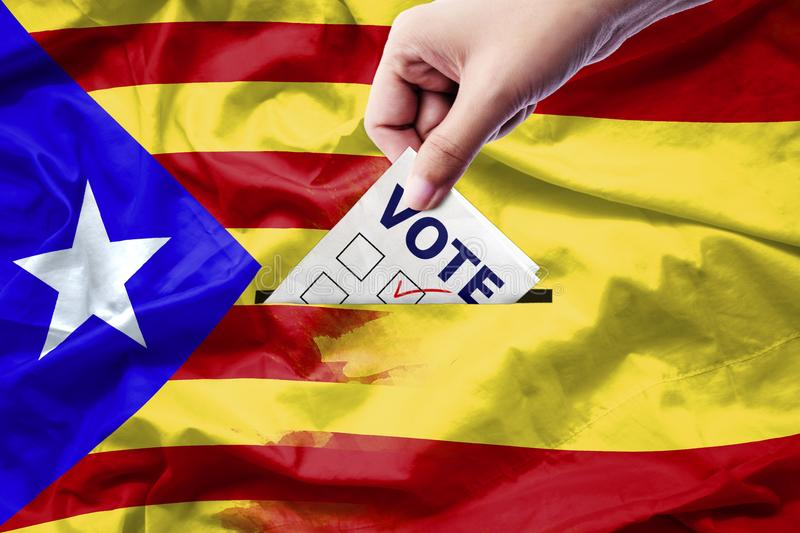 Vote referendum for Catalonia independence exit national. Crisis separatism risk : close up hand of a person casting a ballot at elections during voting on stock photography