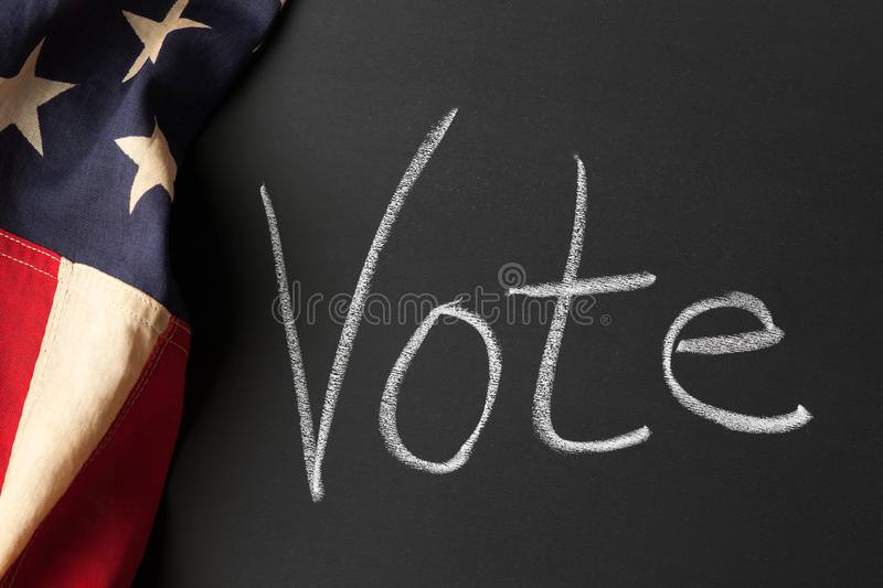 Vote sign. A vote sign with vintage American flag royalty free stock photos
