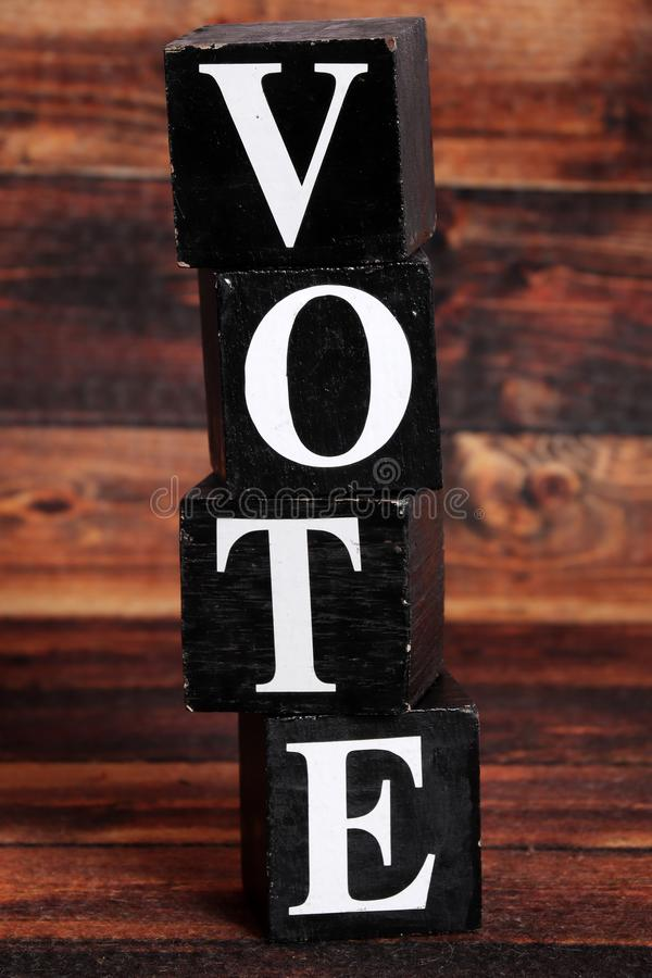 Vote. Spelled on black blocks stock image