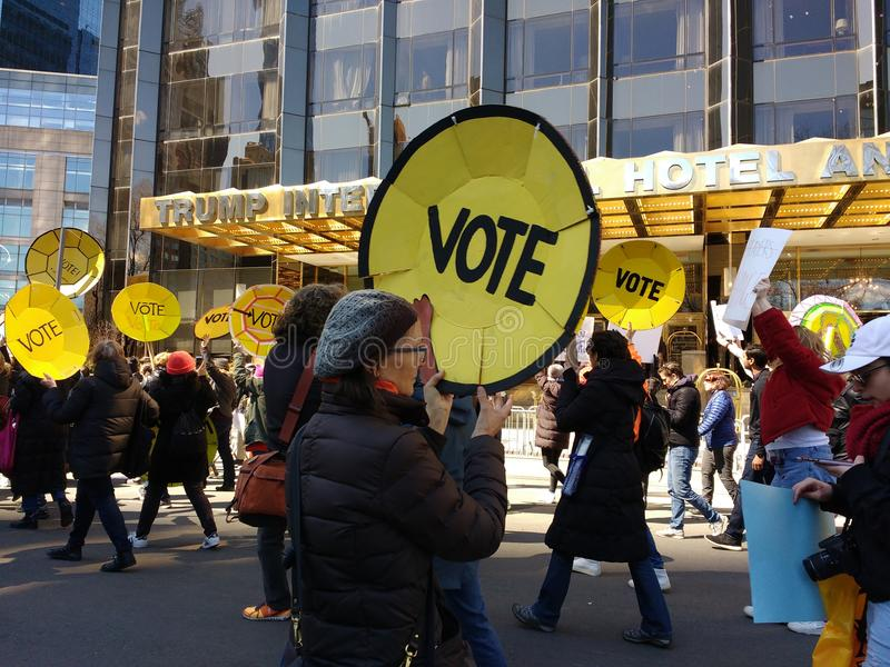 Vote, Trump International Hotel & Tower, March for Our Lives, Protest for Gun Reform, NYC, NY, USA. Demonstrators carrying shield-like signs encouraging people stock images