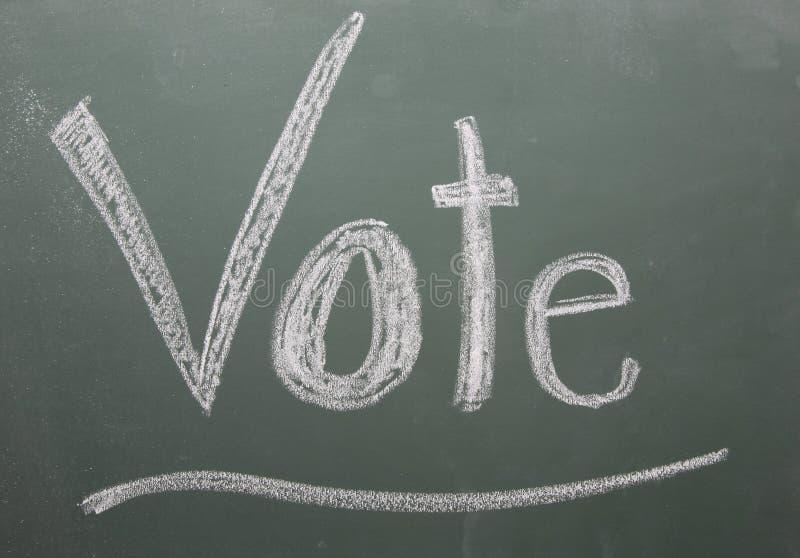 Vote Written on Blackboard stock photo