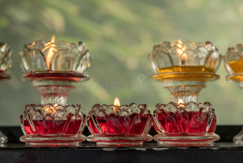 Votive candles in glass dishes at Wild Goose Pagoda. Colorful votive candles in glass dishes at Giant Wild Goose Pagoda in Xi`an royalty free stock images