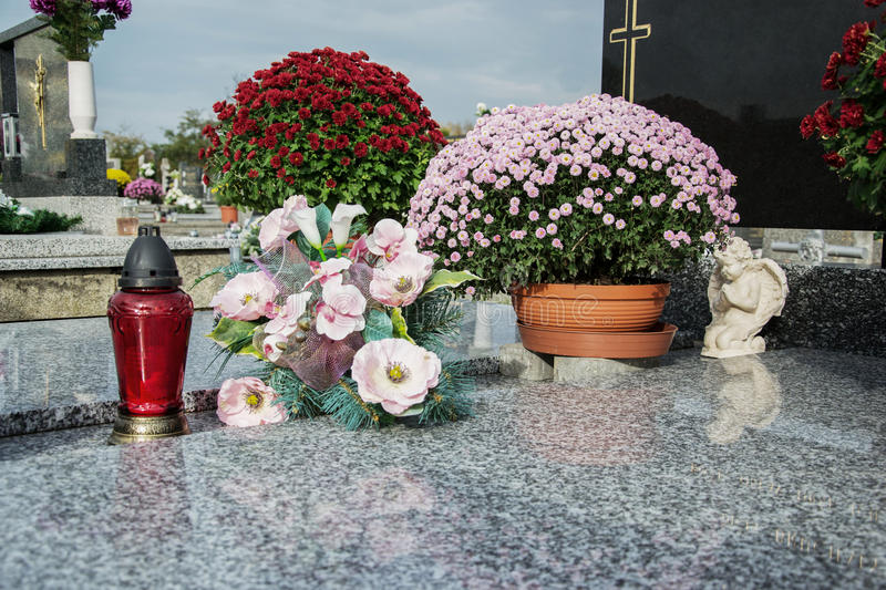 Download Votive Candles Lantern And Chrysanthemum Flowers On Tomb Stones In Graveyard. Graves, Tombstones On Traditional Cemetery Stock Photo - Image of flower, bury: 78112026