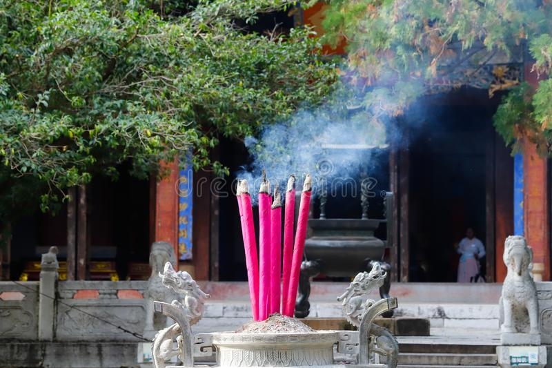 Votive candles in the Temple of Confucius, the largest of the.Yunnan, China. Jianshui, Yunnan, China stock image