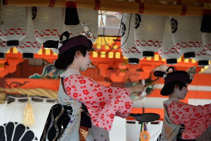 Votive dance by Geisha girl, at Gion Matsuri festival. Geisha girls dedicate their dancing and beating hand drum for the holiness of Yasaka Shrine, on the royalty free stock images