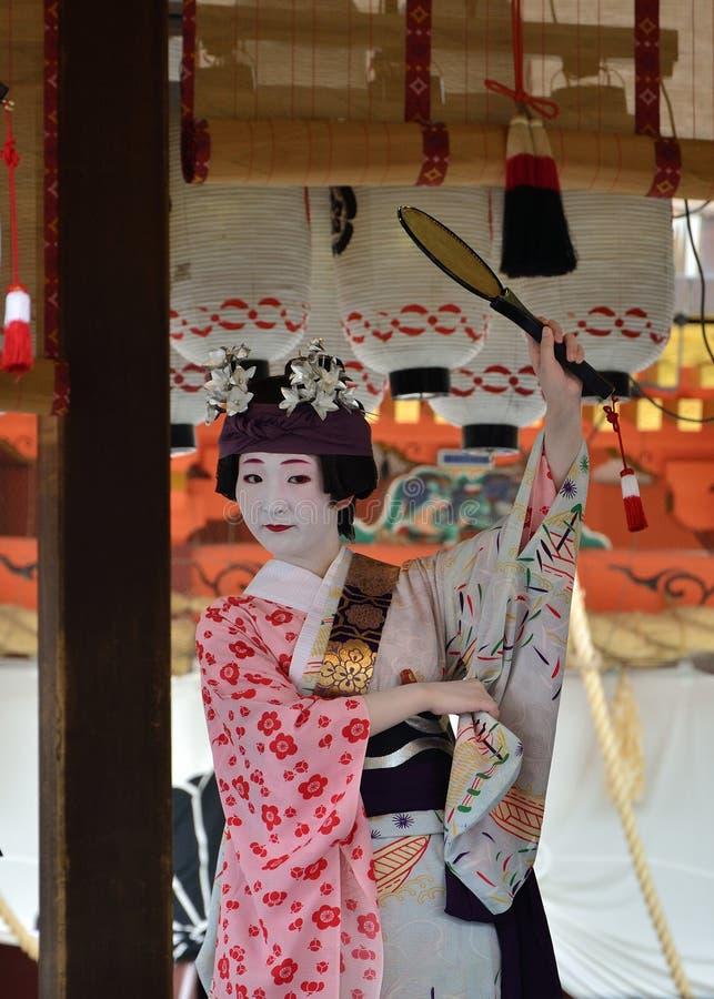 Votive dance by Geisha girls, Gion festival scene. Geisha girls dedicate their dancing for the holiness of Yasaka Shrine, on the festival day of Gion Matsuri stock images