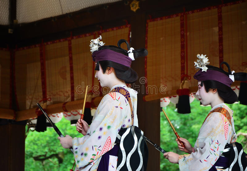 Votive dance by Geisha girls, Gion festival scene. Geisha girls dedicate their dancing for the holiness of Yasaka Shrine, on the festival day of Gion Matsuri stock photo