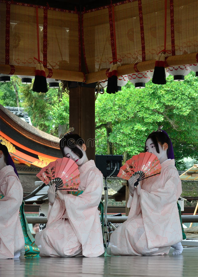 Votive dance by Maiko girls, Gion festival scene. Little Maiko girls dedicate their dancing for the holiness of Yasaka Shrine, on the festival day of Gion stock image