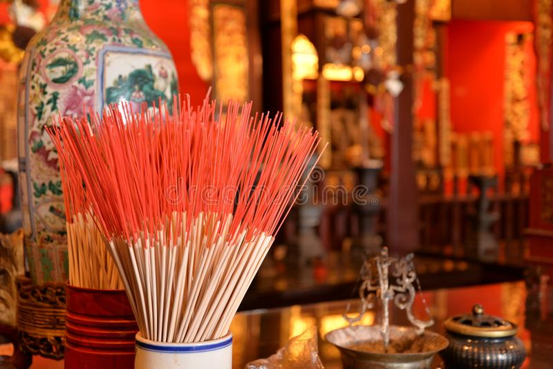 Incense sticks in a Chinese Confucian temple.. Votive incense sticks in a Chinese confucian temple. Worship rituals, Chinese religion royalty free stock images