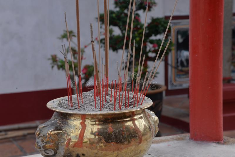 Incense sticks in a Chinese Confucian temple.. Votive incense sticks in a Chinese confucian temple. Worship rituals, Chinese religion royalty free stock image