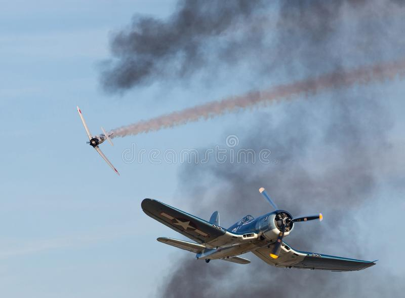 Vought F4U Corsair Fighter in Aerial Combat. A Vought F4U Corsair fighter and Japanese Zero recreate an aerial dogfight in the Pacific Theater during World War stock image