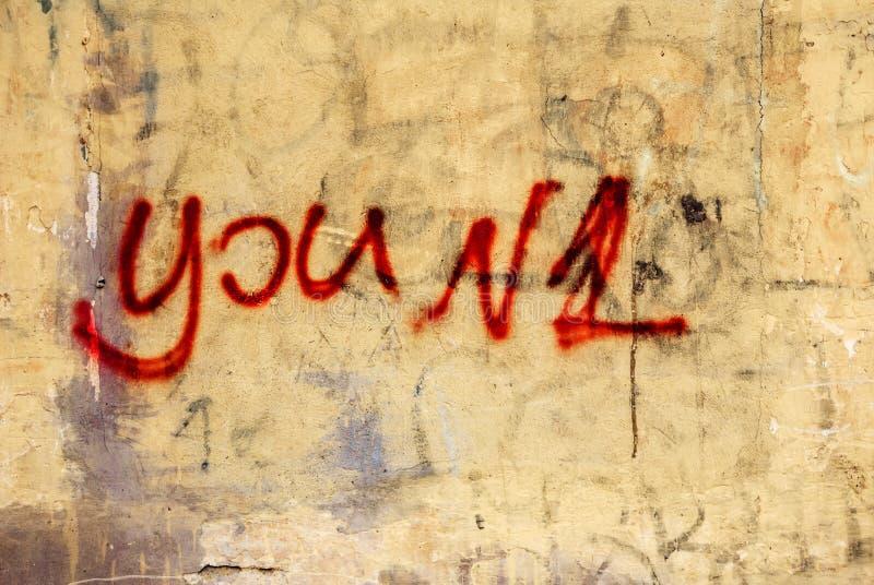 Vous num?ro un ?crit, peint sur le mur en b?ton art de mur d'expression comme le graffiti images libres de droits