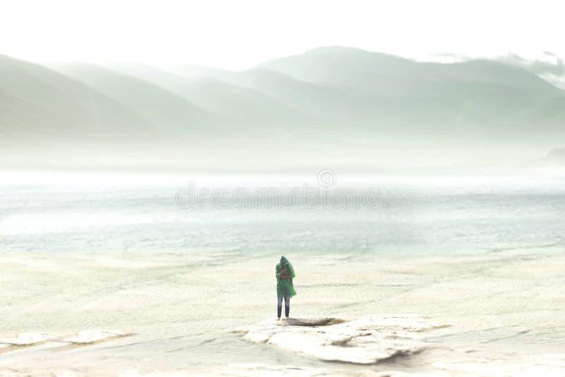 voyageur sous la pluie au pied d'une montagne verdoyante photographie stock libre de droits