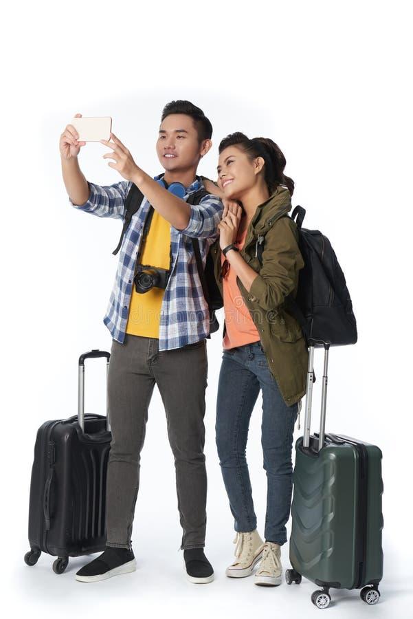 Voyageurs prenant le selfie photo stock