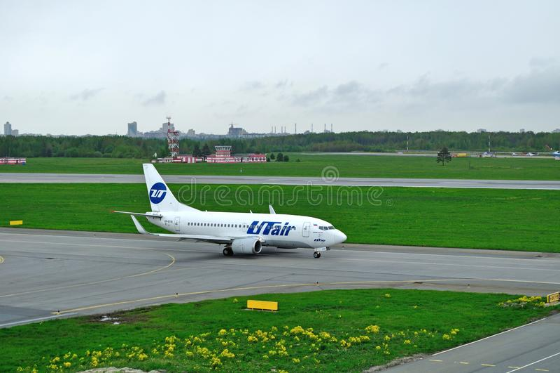 VP-BYM UTair Airline Boeing 737-500 airplane prepares for departure from the runway of Pulkovo International Airport. Saint Petersburg, Russia - May 23,2015. VP royalty free stock photos