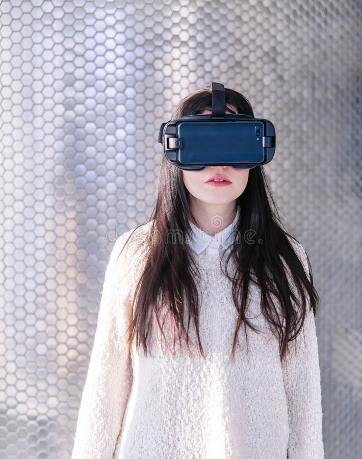 VR background white reflection girl face phone Woman virtual reality headset brunette phone stock image