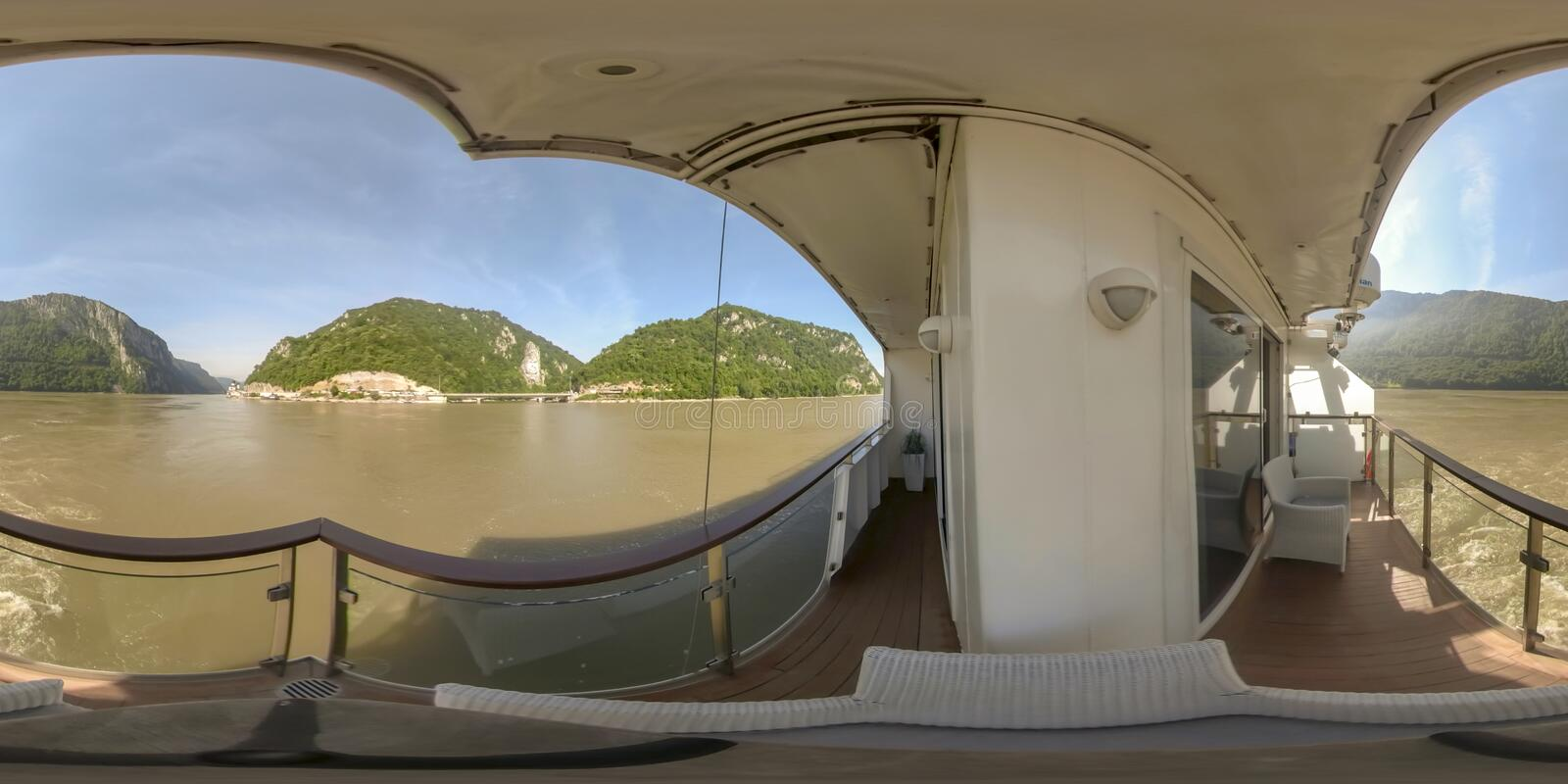 360VR Cruising through Iron Gate on Danube River. 360VR cruising on riverboat through the Iron Gate gorges on the Danube River between Serbia and Romania royalty free stock image