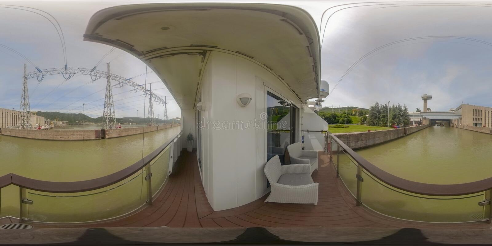 360VR Cruising through Iron Gate2 power plant. 360VR cruising on riverboat through the Iron Gate 2 hydroelectric power plant locks on the Danube River between stock image