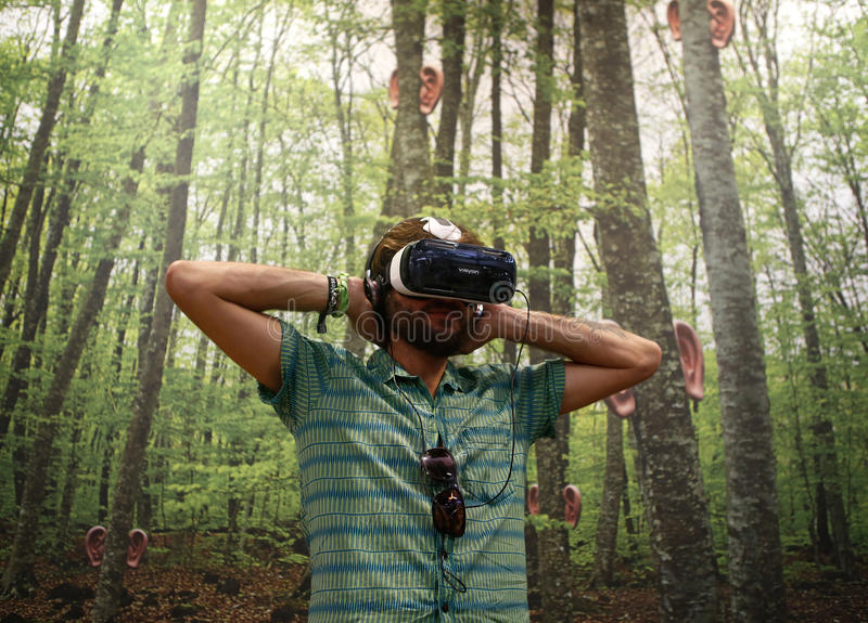 Vr devices testing. A man gestures while wearing virtual reality VR equipment during Sonar advanced technology music and arts festival in barcelona stock image