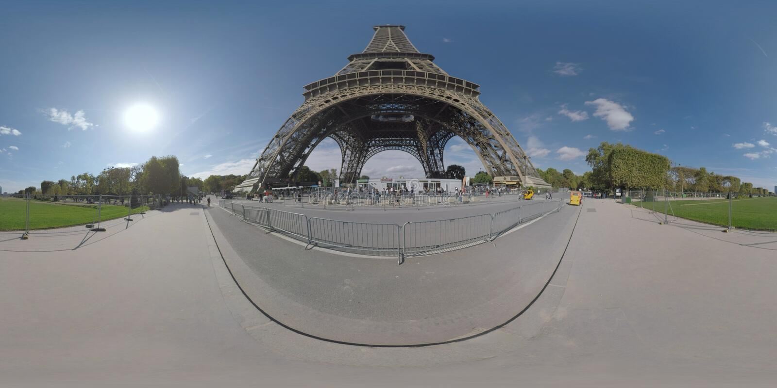 360 VR Gustave Eiffel Avenue with view to Eiffel Tower and Champ de Mars. 360 photo - City scene with people walking on Gustave Eiffel Avenue near the Eiffel stock photos