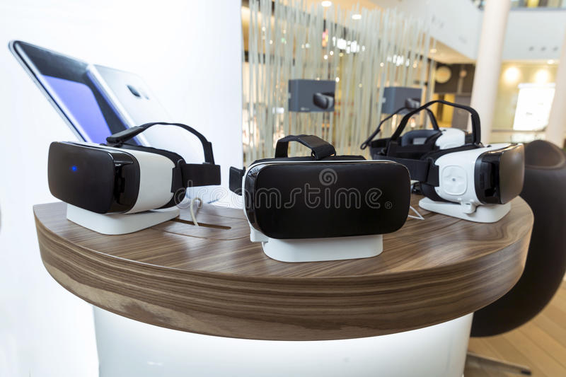 VR headsets, virtual reality sets, VR glasses. Virtual reality (VR) headsets (glasses) on a table. VR is immersive multimedia or computer-simulated reality - a stock photography