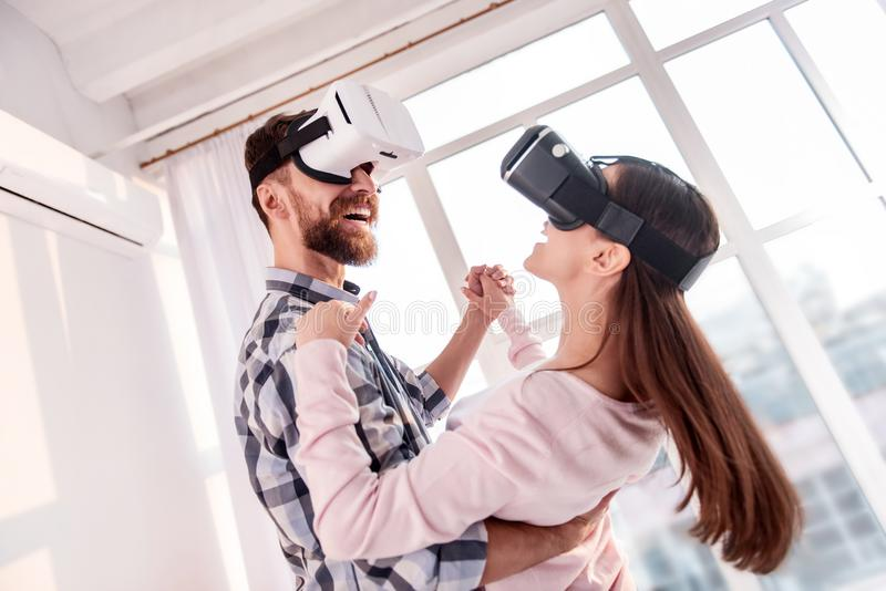 Sweet loving couple whirling in VR stock photography