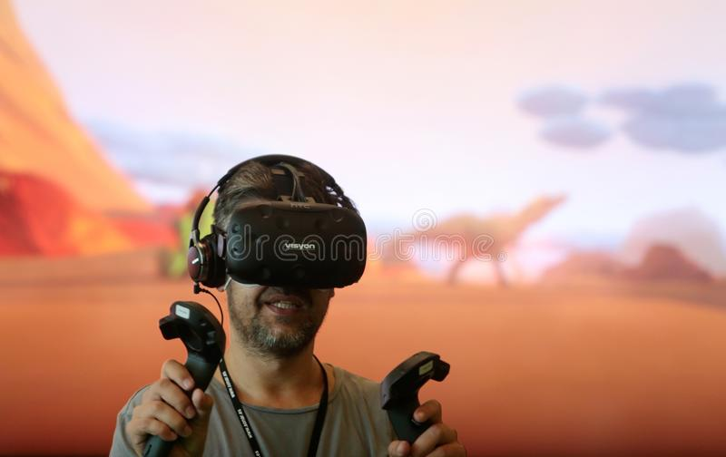 Vr sets at sonar festival. People test different virtual reality models and environments during sonar advanced music and arts in barcelona stock image
